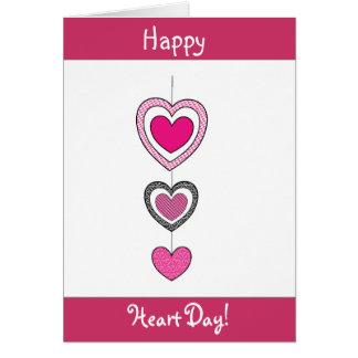 Cartão feliz do dia dos namorados dos corações