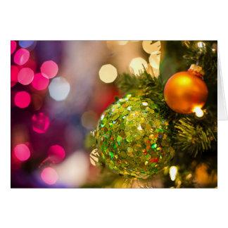 Cartão Feliz Natal, brilho das bolas do Natal