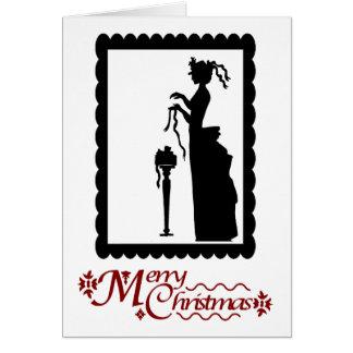 Cartão Feliz Natal, senhora com um pacote