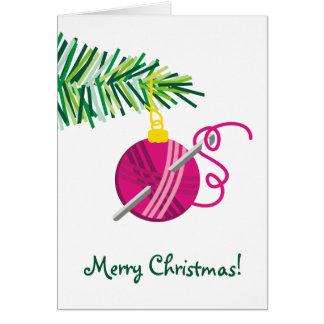 Cartão Feriado de confecção de malhas do Natal da bola do