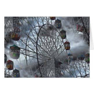 Cartão Ferris roda dentro as nuvens