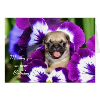 Cartão Filhote de cachorro do Pug nos pansies