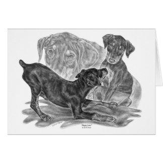 Cartão Filhotes de cachorro do Pinscher do Doberman que