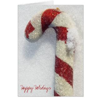 Cartão Foto real da neve dos bastões de doces do feriado