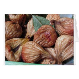 Cartão Frutas do outono. Close up de figos secados com