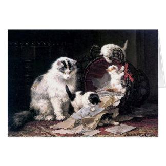 Cartão Gatos impertinentes dos gatinhos que jogam com a