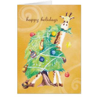Cartão Girafa que mordisca na árvore de Natal