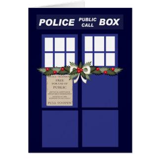 Cartão Grinalda do Natal em uma caixa de polícia