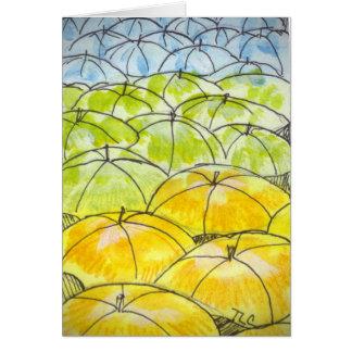 Cartão guarda-chuvas na primavera