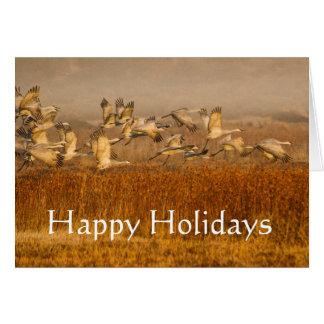 Cartão Guindastes sobre o campo dourado, boas festas