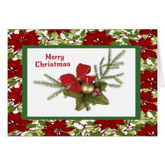 Cartão Hortaliças do Natal no fundo da poinsétia
