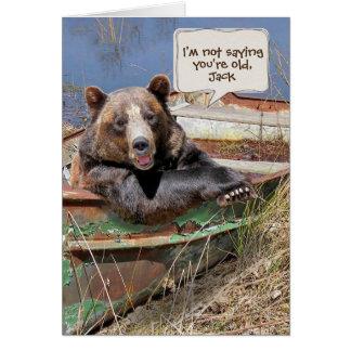 Cartão humor-urso do aniversário no barco a remos oxidado