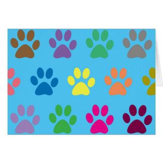 Cartão Impressão colorido das patas do filhote de