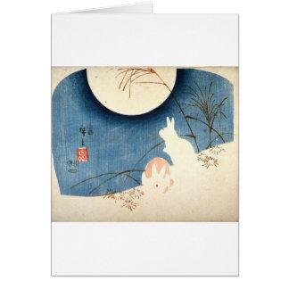 Cartão Intitulado (dois coelhos, gramas de Pampas, e Luas