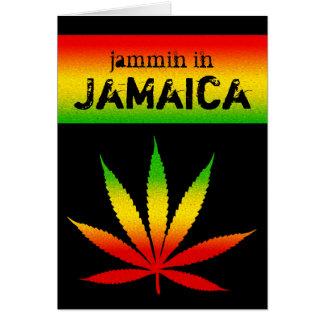 Cartão Jammin na reggae de Jamaica colore o preto da
