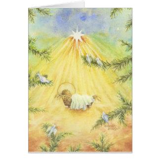Cartão Jesus do Natal no comedoiro com pombas