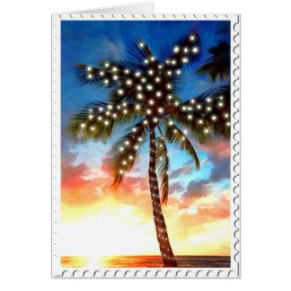 Cartão Luzes da palmeira do feriado no por do sol