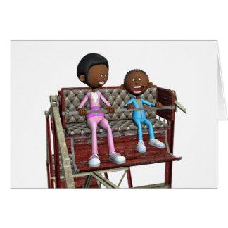 Cartão Mãe e filho dos desenhos animados em uma roda de