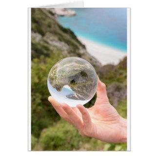 Cartão Mão que guardara a bola de cristal perto do mar e