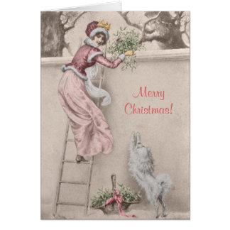 Cartão Menina do vintage com Natal do visco e do cão