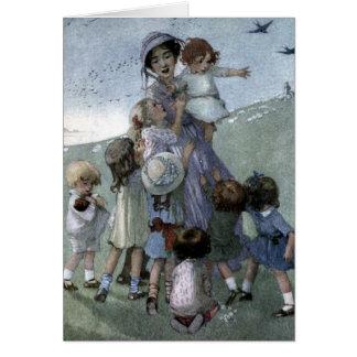 Cartão Mulher e crianças em um prado,