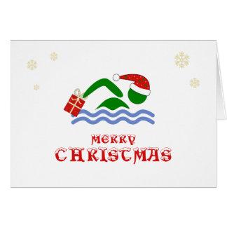 Cartão Nadador do Feliz Natal que traz o presente