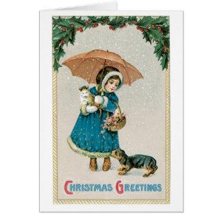 Cartão Natal antiquado, menina com gato e cão