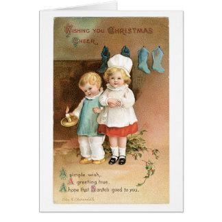Cartão Natal antiquado, menino & menina