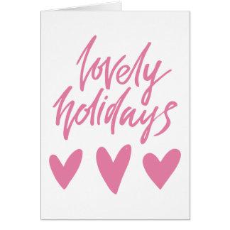 Cartão Natal cor-de-rosa bonito dos corações dos feriados