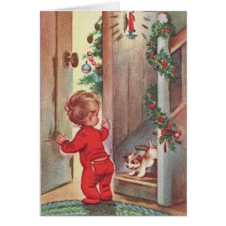 Cartão Natal da criança e do filhote de cachorro do