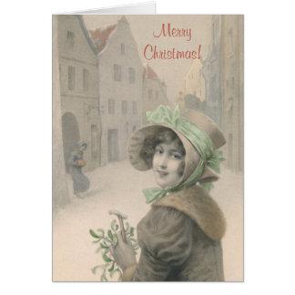 Cartão Natal da menina e do visco do vintage
