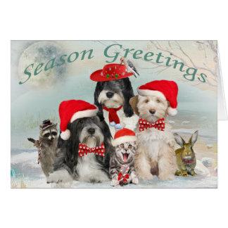 Cartão Natal de Terrier tibetano com amigos