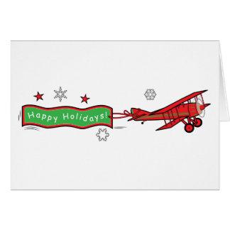 Cartão Natal do biplano do avião boas festas