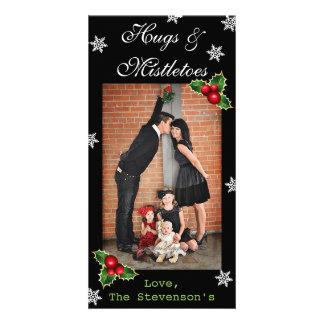 Cartão Natal do vertical dos abraços & dos viscos