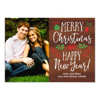 Cartão Natal indicado por letras do Woodgrain da mão