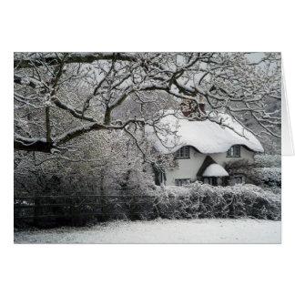 Cartão nevado da casa de campo