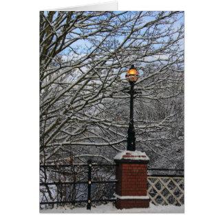 Cartão nevado da lâmpada