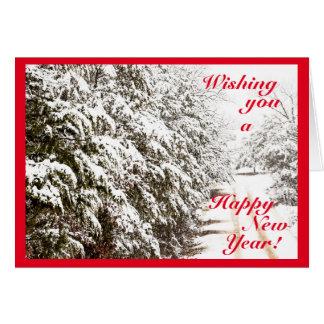 Cartão nevado do feliz ano novo