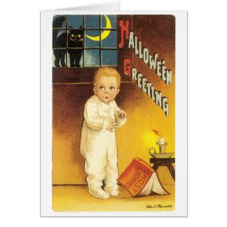 Cartão O Dia das Bruxas antiquado, menino & gato preto