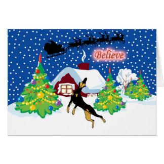 Cartão O Doberman acredita no Natal do papai noel