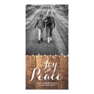 Cartão O Natal da paz da alegria deseja as luzes v2 da