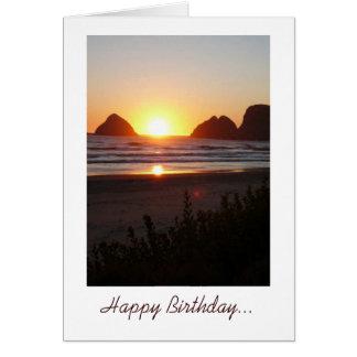 Cartão O por do sol do feliz aniversario na praia toes no