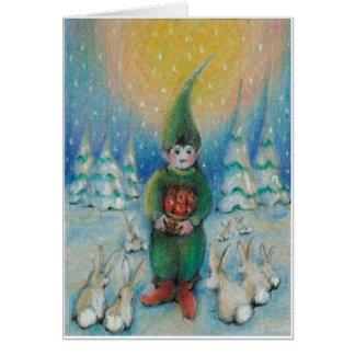 Cartão O tomte do menino alimenta coelhos da neve com