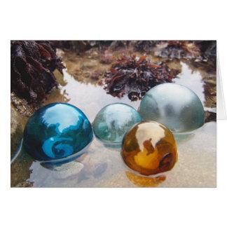 Cartão O vidro flutua na água