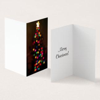 Cartão obscuro das luzes do Feliz Natal
