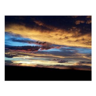 Cartão ocidental do por do sol