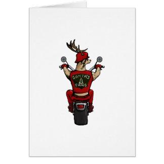 Cartão Os cervos do papai noel que montam uma bicicleta
