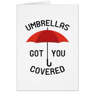 Cartão Os guarda-chuvas obtiveram-no coberto