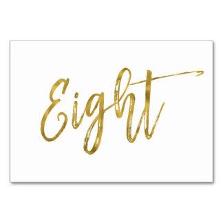Cartão Ouro e mesa elegante branca número oito