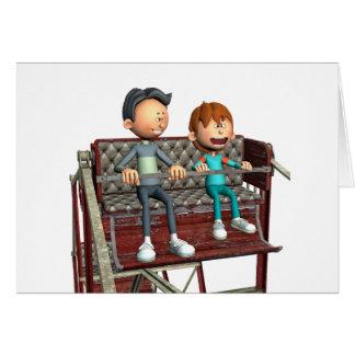 Cartão Pai e filho dos desenhos animados em uma roda de